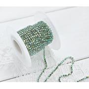Стразовая лента (цепь) SS8 радужная в серебристой оправе (1метр)